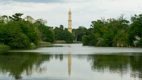 Tower of Minaret in the meander. Tower of minaret with half-moon sign on it in the middle of the meander. Photo taken from the wooden bridge in the large parks stock photography