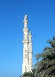 Tower minaret of a mosque Stock Photos