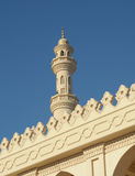 Tower minaret of a mosque Stock Images