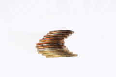 Tower of money. Metal money on the white background. Royalty Free Stock Photos
