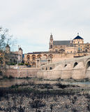 Tower of the Mosque of Cordoba. Cathedral next to the mosque of Cordoba, image taken from the base of the bridge, the river is Giuadalquivir passage through the Stock Image