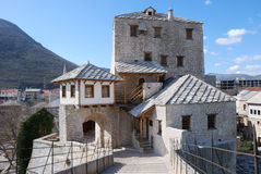 Tower in Mostar Old Town. View from the Old Bridge on the west tower in Mostar old town on a sunny day Royalty Free Stock Photos