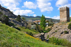 Tower in the mountains. Spring in the Crimean mountains near Sudak Stock Images