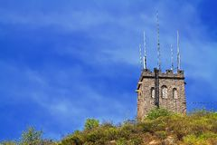 Tower on a moutain under the blue Stock Photography