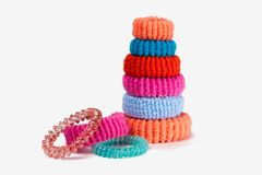 Tower of multi-colored rubber bands for hair Stock Images