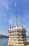 Tower near Chains bridge on riverbank in Budapest. Stock Images