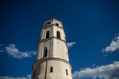 Tower near the St. Stanislaus Cathedral on Cathedral Square in the historic part of the old city of Vilnius. Lithuania royalty free stock images