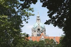 New City Hall in Hannover Germany framed by trees Stock Photo