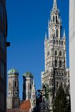 Tower of the New Town Hall and Frauenkirche of Munich. The new town hall of Munich, Bavaria, Germany. Situated in Marienplatz is one of the symbols of Munich Royalty Free Stock Images