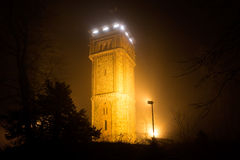 Tower in the night fog Stock Photography