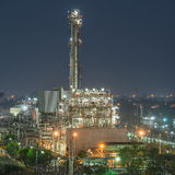Tower of oil refinery at twilight Royalty Free Stock Image