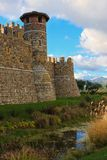 A tower of an old castle. An old castle and a moat Royalty Free Stock Image