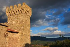A tower of an old castle. Against a cloudy sky Stock Photo