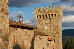 A tower of an old castle. Against a cloudy sky Royalty Free Stock Image