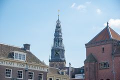 Tower of the old church in the center of Amsterdam, Netherlands Royalty Free Stock Photography