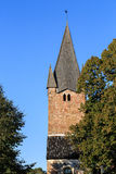 Tower of old church with trees Stock Photos