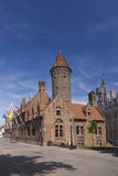 Tower and old houses in Bruges Stock Photo