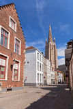 Tower and old houses in Bruges Stock Photos