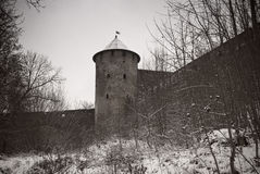 Tower of an old medieval fortress. Tower of the medieval fortressin winter Royalty Free Stock Photography