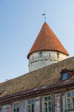 Tower and old style house on foreground, Tallinn Stock Photography