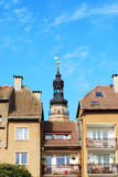 Tower of old town hall. Renewed historic tower of town hall and fragment of blocks of apartment in old town in Glogow, Poland Royalty Free Stock Image