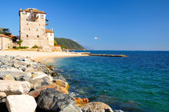 Tower of Ouranoupoli. Old byzantine tower at the beach of Ouranoupoli, Chalkidiki, Athos Peninsula, Greece Royalty Free Stock Photo