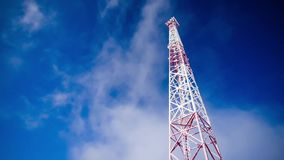 Tower over blue sky. Realtime HD footage with communications tower and clouds, photographed on Nikon D800 camera stock video
