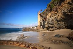 Tower over Rocky shores at Victoria Beach in Laguna Beach. California on a sunny day Stock Photo