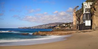 Tower over Rocky shores at Victoria Beach in Laguna Beach. California on a sunny day Stock Photos