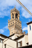 Tower of Palazzo Vecchio over houses in Florence Royalty Free Stock Photography