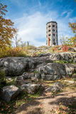 Tower in a park. Stone tower in a public park during fall time Royalty Free Stock Photo