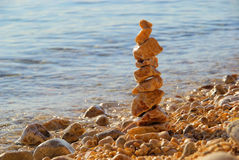Tower from pebbles. Stones on the beach Royalty Free Stock Photography