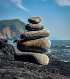 Tower of pebbles alongside beach. A tower made out of pebbles, stacked one on top of another Stock Photography