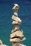 Tower from pebbles. Harmony tower from grey pebbles Stock Photos