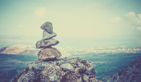 Tower of pebbles. And panorama of greek Kos island Royalty Free Stock Photography