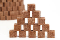 Tower from pieces of sugar. Tower from pieces of brown sugar Stock Photo