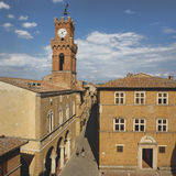 Tower in Pienza, Tuscany. One of several tall bell and clock towers in the beautiful Renaissance town of Pienza in the heart of Tuscany, Italy Royalty Free Stock Images