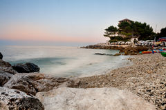 Tower and pine trees on a beach at sunset Royalty Free Stock Photography