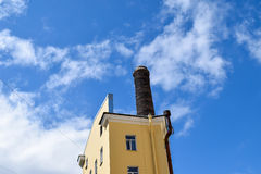 Tower with a pipe at the blue sky.  Royalty Free Stock Photo