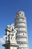 Tower of Pisa and statue Stock Images