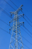 Tower of power. High voltage power transmission tower Under the blue sky Royalty Free Stock Photos