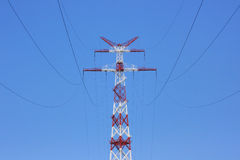 Tower of power line on against blue sky. Royalty Free Stock Photography