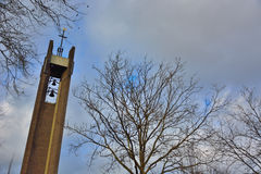 Tower of a protestant church and tree-tops Royalty Free Stock Image