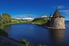 Tower of the Pskov Kremlin in the evening. Stone tower and Pskov Kremlin fortress wall at the confluence of two rivers, Russia Stock Photography