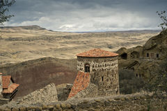 Tower. With red roof in an ancient castle in the Caucasus mountains royalty free stock photos