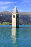 Tower of Resia Lake Church Stock Photo