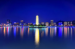 Tower on the river and the river city architecture night Royalty Free Stock Photo
