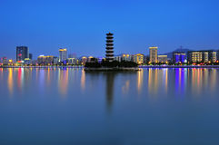 Tower on the river and the river city architecture night Royalty Free Stock Images