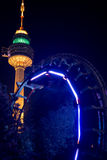 The tower and the rollercoaster ,Duryu Park Tower Starry Night Illuminations Daegu South Korea. Daegu Tower behind a lighted rollercoaster in action going stock image