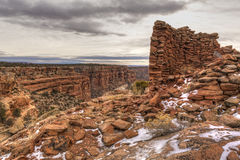 Tower Ruin on Mule Canyon. Snow-covered remnants of an Anasazi tower ruin on the rim of Mule Canyon in the Cedar Mesa area of Bears Ears National Monument Royalty Free Stock Photos